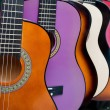 Row of multi-colored mexican guitars — Stock Photo