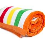Striped beach towel on white — Stock Photo