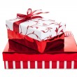 Stack of red and white wrapped Christmas presents — Stock Photo #13625316