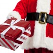 Santa Claus giving Christmas presents — Stock Photo