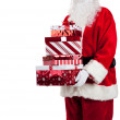 Santa Claus giving Christmas presents — Stock Photo #13625331