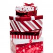 Stack of red and white wrapped Christmas presents — Stock Photo #13625337