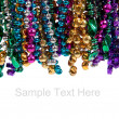 Mardi gras beads on white with copy space - Stock Photo