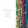Mardi gras beads on white with copy space - Photo
