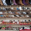 Rows of assorted shoes, sandals, and boots — Stockfoto
