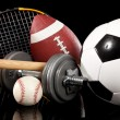 Assorted sports equipment on black — Stock Photo