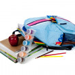 Blue backpack full of supplies on white — Stock Photo #13625774