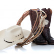 Cowboy hat, boots and lariat on white — Stock Photo