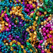 Background of mardi gras beads — Stock Photo