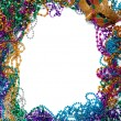 Border made of mardi gras bead and mask on white - Stock Photo