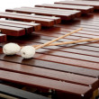 A Wooden Marimba and mallots background - Stock Photo