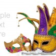 Several mardi gras masks on white with copy space — Stock Photo #13626114