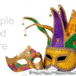 Several mardi gras masks on white with copy space - Stock Photo