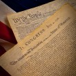 The United States Constitution and Declaration of Independence on a flag ba - Stock Photo