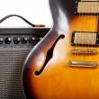 Electric guitar and amplifier on white background — Photo