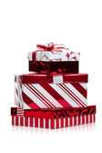 Red and white wrapped Christmas present on white — Stock Photo