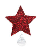 A red glittery Christmas star on white — Stock Photo