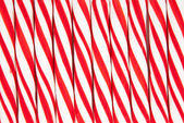Background made of red and white candy canes — Stock Photo