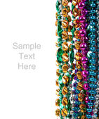 Mardi gras beads on white with copy space — Foto de Stock