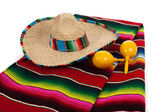 Serape, sombrero and maracas on a white background — Stock Photo
