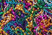 Background of mardi gras beads — Stock Photo