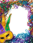 Border made of mardi gras bead and mask on white — Stock Photo