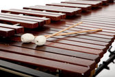 A Wooden Marimba and mallots background — Stock Photo