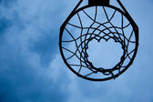 Basketball hoop with sky background — Stock Photo