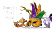 Several mardi gras masks on white with copy space — Stock Photo