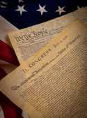 The United States Constitution and Declaration of Independence on a flag ba — Stock Photo