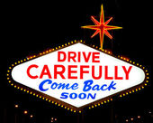 """The reverse of the Las Vegas sign reading """"Drive Carefully"""" — Stock Photo"""