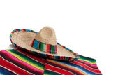 Serape and sombrero on a white background with copy space — Stock Photo