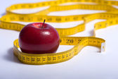 Red Apple and a Tape Measure — Stock Photo