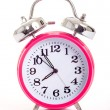 Foto Stock: Pink alarm clock on white background
