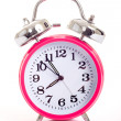 图库照片: Pink alarm clock on white background