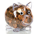 Clear Plastic piggy bank full of pennies — Stock Photo
