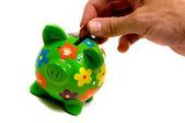 Green Piggy Bank Getting Money — Stock Photo