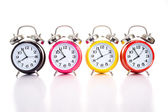 Multi-color clocks on white — 图库照片