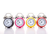 Row Of Alarm Clocks on WHite — Stock Photo