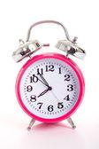 Een roze wekker op een witte achtergrond — Stockfoto