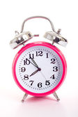 En rosa väckarklocka på vit bakgrund — Stockfoto