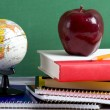 School Books a red Apple and a Globe — Stock Photo
