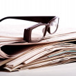 Reading Glasses on Newspapers — Stock Photo