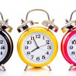 Multi-color clocks on white — Stock Photo