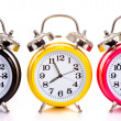 Foto Stock: Multi-color clocks on white