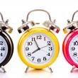 Multi-color clocks on white — Stock Photo