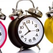 Foto Stock: Colorful Clocks on White