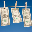Stock Photo: Two Dollar Bills on Clothesline