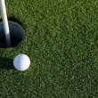 Stock Photo: Golf Ball Near Hole