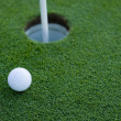 Golf Ball Near Hole — Stock Photo #13643413